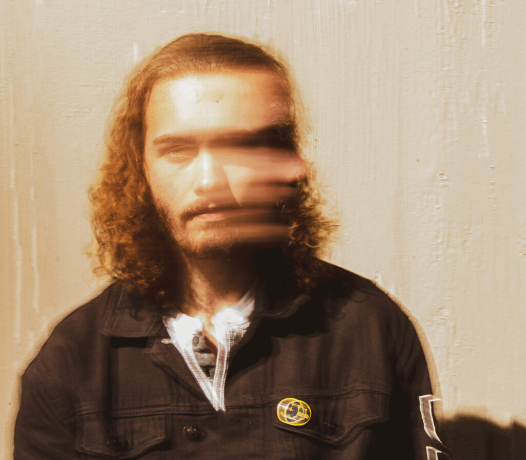 A photograph of a person turning their head to their left shoulder. The photograph captures the blur of that movement.